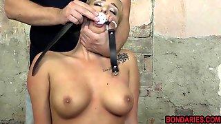 Busty blonde babe enjoying some painful sub and vibe session