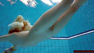 Blonde in a dress in a pool