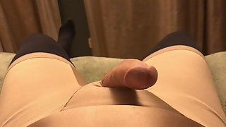 Crossdresser Playing in Girdle and Tights