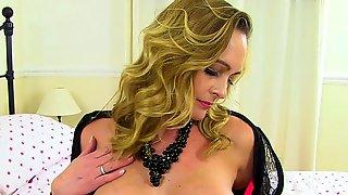 Pantyhosed milf Elegant Eve from the UK fucks a dildo
