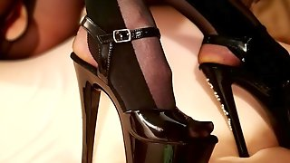 Shoejob and cumshot on wife's high heels