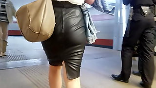 Woman's ass in leather skirt