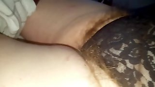 Wifes long hairy pubes hanging from her black girdle