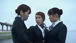 Three japanese airline stewardess kissing!
