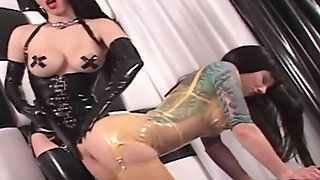 Busty Rubber Doll Spanks & StrapOn Fucks Rubber Painted Lady