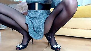 Lady with long legs wearing pantyhose masturbate