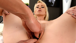 Hot babe fisting her girlfriend's pierced pussy