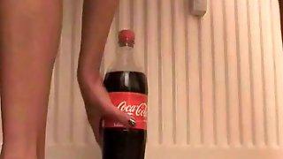 Nympho and coke 2 liter bottle