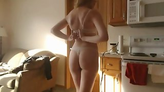 Beautiful Babe Teasing in The Kitchen