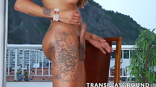 Tall bubble butt Latina TS strips and strokes her huge cock