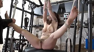 Kinky Beauvoir enslaved and tied up in dungeon bondage