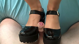 Shoejob and cum on her black patent chunky heels