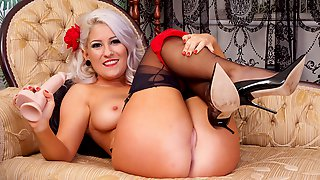 Busty babe strips off retro lingerie toys wet pussy in nylon