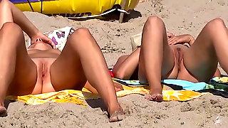 Two nude girls on beach